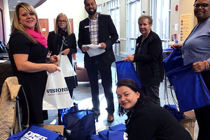 Visions employees providing financial wellness education