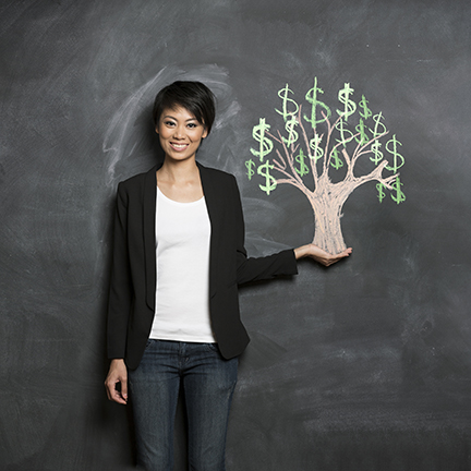 asian woman standing nest to a tree made of money