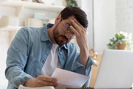 stressed man doing bills
